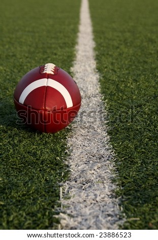Collegiate football on the yardline - stock photo