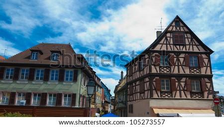Colmar - half-timbered medieval houses against blue sky, Alsace, France - stock photo