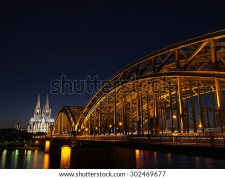 Cologne Cathedral and Hohenzollern Bridge at night - Cologne, Germany - stock photo
