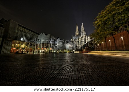 Cologne Cathedral and Hohenzollern Bridge, Cologne, Germany. Night photo. - stock photo