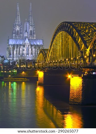 Cologne Cathedral and iron Bridge at night in Cologne, Germany - stock photo