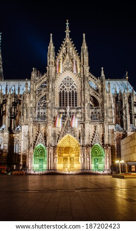 Cologne Cathedral (Kolner Dom) detail of the facade at night - stock photo