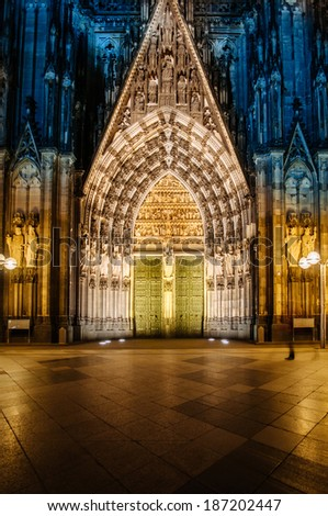 Cologne Cathedral (Kolner Dom) facade of stone door at night - Cologne (Koln) Germany - stock photo