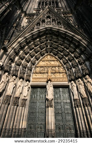 Cologne cathedral of Saint Peter and Mary door taken with extremely wide angle lens. Famous church. Seat of Archbishop. UNESCO World Heritage Site. - stock photo