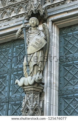 Cologne Cathedral statue, central figure of St Michael vanquishing the Devil - stock photo
