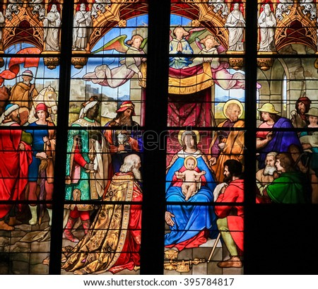 COLOGNE, GERMANY - APRIL 21, 2010: Epiphany - Adoration of the Magi - Stained Glass in Dom of Cologne, Germany - stock photo