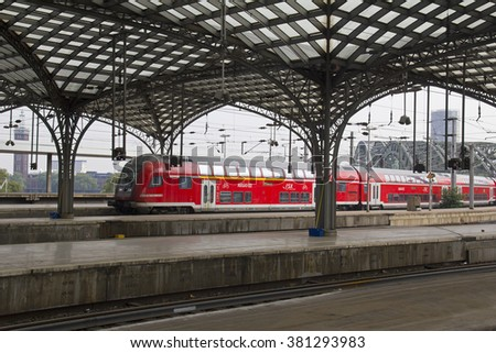 Cologne, Germany - August 30, 2013: Local German train arrives in the historic railway station of Cologne, Germany on August 30, 2013 - stock photo