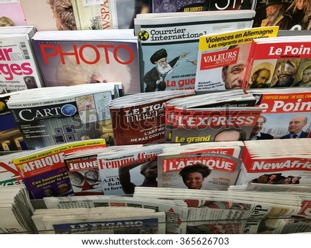 Cologne,Germany- January 21,2016: Popular french magazines on display in a store in Cologne,Germany    - stock photo