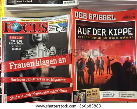 Cologne,Germany- January 11,2016: Popular german magazines on display in a store in Cologne,Germany  - stock photo