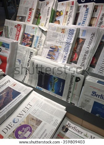 Cologne,Germany- January 5,2013: Popular german newspapers in german language on display in a store in Cologne,Germany  - stock photo