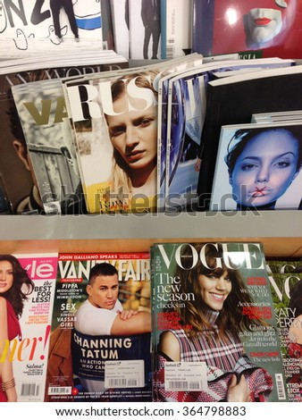 Cologne,Germany- July 24,2013: Popular british magazines in english language on display in a store in Cologne,Germany - stock photo