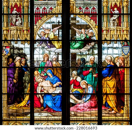 COLOGNE, GERMANY - JULY 21:Stained glass church window with Lamentation over the Dead Christ in the Dom on July 21, 2014 in Cologne  - stock photo