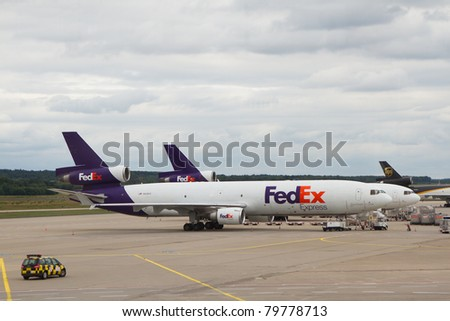 COLOGNE, GERMANY - JUNE 13: Fedex McDonnell Douglas DC-10 airplane in Cologne airport, Germany on June 23, 2011. Fedex is the biggest shipping/cargo company in the world serve over 300 destinations worldwide - stock photo