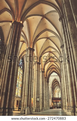 COLOGNE, GERMANY - MARCH 18, 2014: Interior of Cathedral - a monument of German Catholicism and Gothic architecture. One of the most visited landmark in country. Vintage effect - faded colors - stock photo