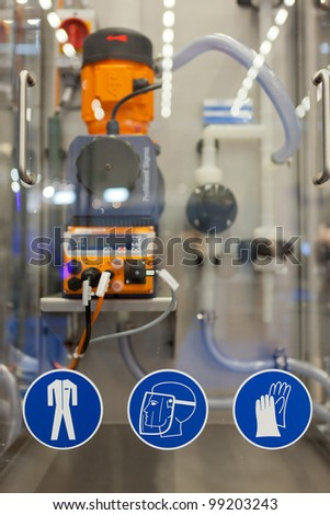COLOGNE, GERMANY - MARCH 27 : New Clean In Place system with work safety pictograms on display at the Loehrke booth at the ANUGA FoodTec industry trade show in Cologne, Germany on March 27, 2012. - stock photo