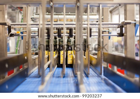 COLOGNE, GERMANY - MARCH 27 : New olive oil packing machine on display at Clevertech booth at the ANUGA FoodTec industry trade show in Cologne, Germany on March 27, 2012. - stock photo