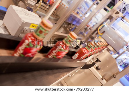 COLOGNE, GERMANY - MARCH 27 : New Orientator for glass bottles on display at the Gronemeyer booth at the ANUGA FoodTec industry trade show in Cologne, Germany on March 27, 2012. - stock photo