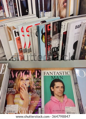 Cologne,Germany- May 15,2013: Popular british magazines in english language on  display in a store in Cologne,Germany - stock photo