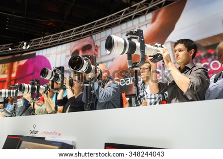 COLOGNE, GERMANY - SEPTEMBER 19, 2014: Canon stand at the Photokina Exhibition. The Photokina is the world's largest trade fair for the photographic and imaging industries - stock photo