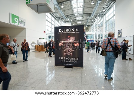 COLOGNE, GERMANY - SEPTEMBER 19, 2014: inside of Cologne Exhibition Centre during Photokina exhibition. The Photokina is the world's largest trade fair for the photographic and imaging industries - stock photo