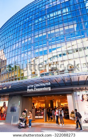 COLOGNE, GERMANY - SEPTEMBER 29, 2015: modern building of the worldwide operating fashion chain Peek & Cloppenburg in Cologne with unidentified people. The building was designed by Renzo Piano. - stock photo
