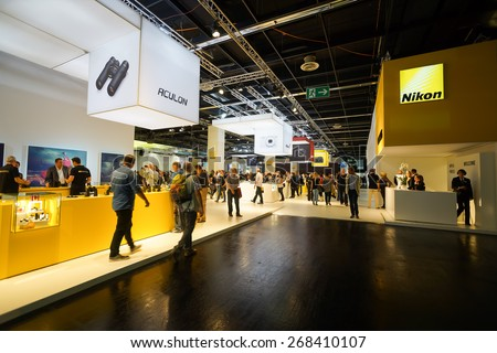 COLOGNE, GERMANY - SEPTEMBER 19, 2014: Photokina Exhibition interior. The Photokina is the world's largest trade fair for the photographic and imaging industries - stock photo