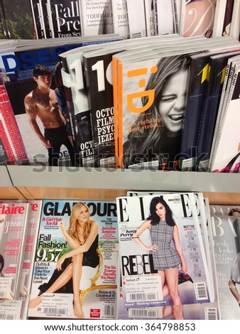 Cologne,Germany- September 4,2013: Popular british magazines in english language on display in a storein Cologne,Germany - stock photo