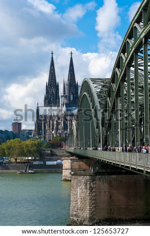 COLOGNE - SEPT 22: Hohenzollern bridge on sept 22, 2012 in Cologne. It is now a rail bridge with six tracks, and due to its location near the main train station about 1200 trains pass here every day. - stock photo