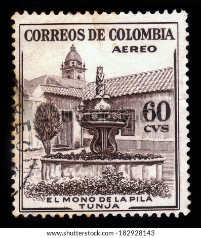 COLOMBIA - CIRCA 1954: A postage stamp printed in Colombia shows the La Pila del Mono Fountain in Tunja, circa 1954 - stock photo
