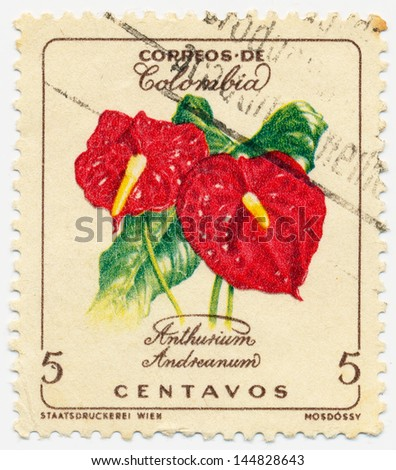 COLOMBIA - CIRCA 1960: A stamp printed in Colombia shows Anthurium andreanum, circa 1960 - stock photo