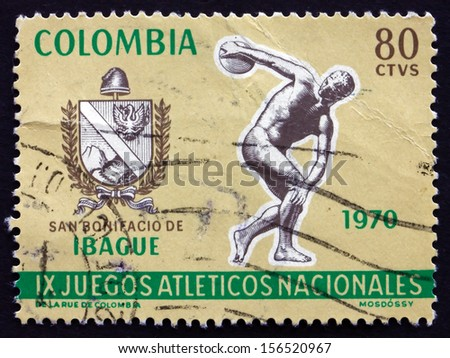 COLOMBIA - CIRCA 1970: a stamp printed in the Colombia shows Arms of Ibague and Discobolus, 9th National Games in Ibague, circa 1970 - stock photo