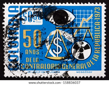 COLOMBIA - CIRCA 1973: a stamp printed in the Colombia shows Symbols of Financial Controls, 50th Anniversary of Comptroller-general'??s Office, circa 1973 - stock photo