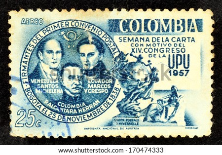 COLOMBIA - CIRCA 1957: Stamp printed in Colombia with image of three Latin America leader, Santos Michelena, Alcantara Herran and Marcos Crespo to commemorate the Postal Convention in Bogota. - stock photo
