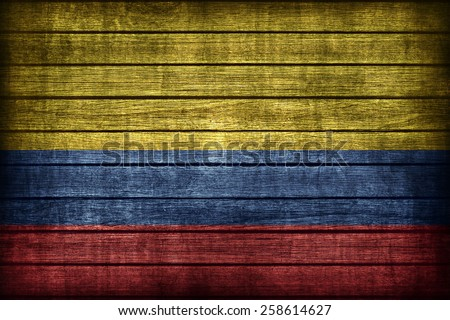 Colombia flag pattern on wooden board texture ,retro vintage style - stock photo