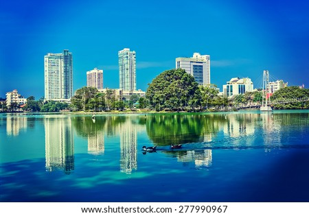 Colombo Beira Lake And Skyline, A Lake In The Heart Of The City Of Colombo That Surrounded By Many Large Businesses In The City (With Instagram Effect) - stock photo