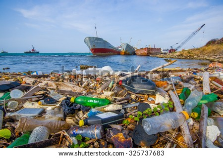 COLON, PANAMA - APRIL 15, 2015: Waste and pollution washing on the shores of the beach in city of Colon in Panama - stock photo