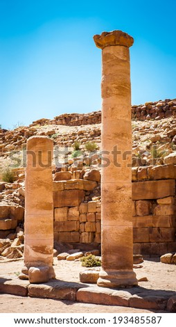 Colonade road in Petra (Rose City), Jordan. The city of Petra was lost for over 1000 years. Now one of the Seven Wonders of the Word - stock photo