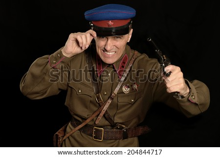 colonel commander with a gun on a dark background - stock photo
