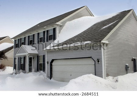 Colonial Home Covered in Snow - stock photo