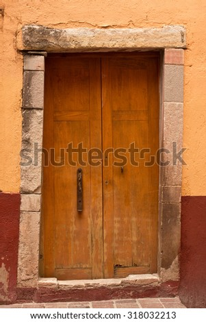 Colonial Wooden Door Entry to old house in Guanajuato, Mexico - stock photo