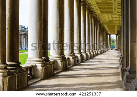 Colonnade and shadow in Old Royal Naval College, University of Greenwich, London. - stock photo