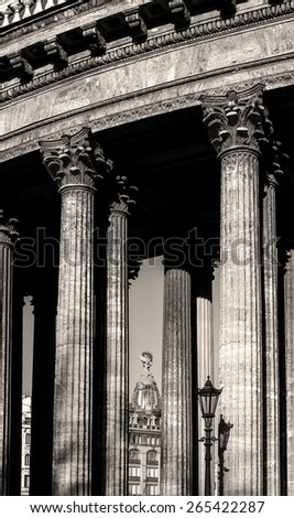Colonnade of the Kazan Cathedral and Singer house between columns (sepia processing) - stock photo