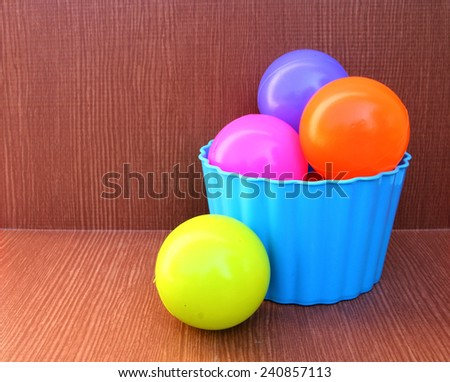 color balls are in the blue plastic box - stock photo