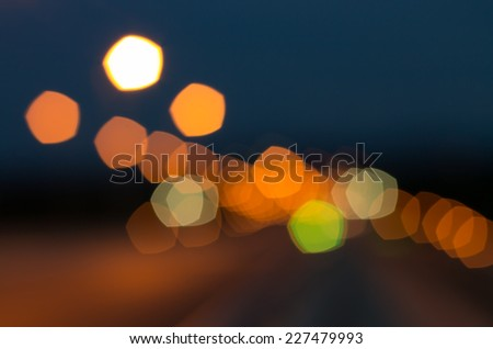 Color Bokeh against a dark background for use at graphic design. - stock photo