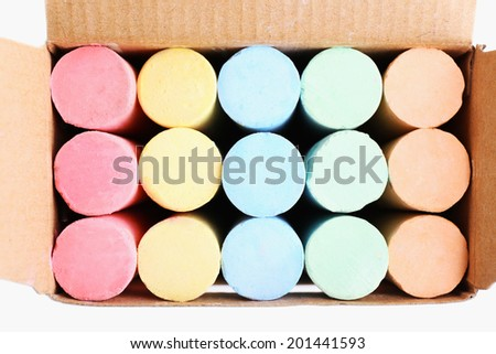 Color chalks in paper box, close up - stock photo