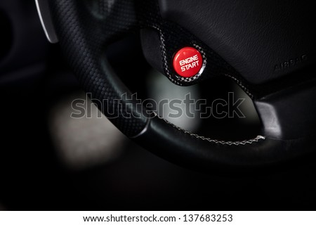 Color detail of a start button in a car - stock photo