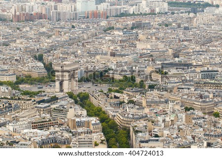 Color DSLR wide angle stock skyline of Paris, France, with the Arc de Triomphe. Urban scene shot from above on top of Eiffel Tower. Horizontal with copy space for text. - stock photo