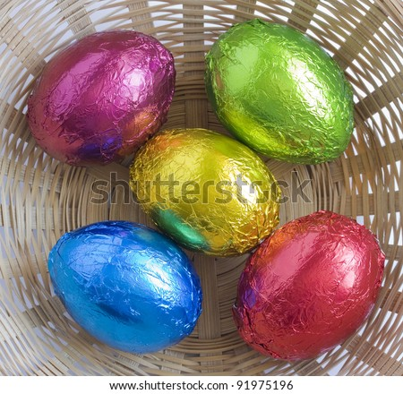 Color Easter eggs in a basket. - stock photo