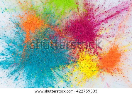 Color explosion concept. Colorful Holi powder exploding on white background closeup. - stock photo