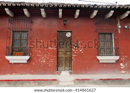 color full faded wall textures and old colonial buildings in Antigua Guatemala - stock photo